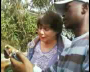 Fayo, showing CJ Jenny how to set and take a video using a cellphone