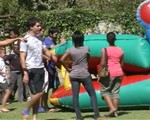Rhodes students having fun with primary school kids at the jumping catle